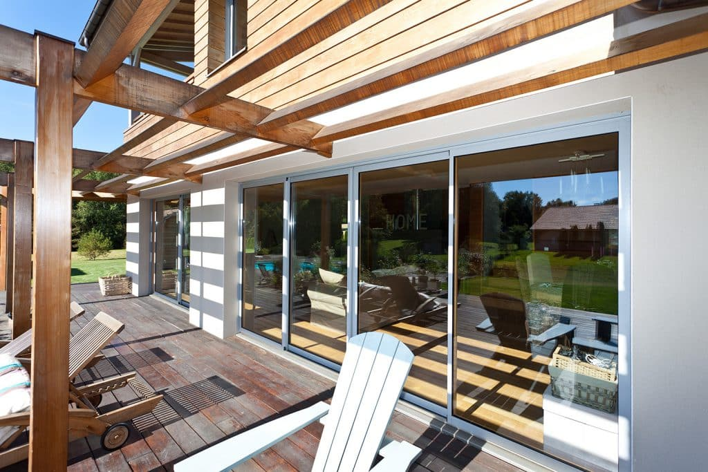 Porte-fenêtre coulissante vantaux mixte alu / bois